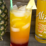 Needing something fruity for your next summertime party? Try this Sunrise Cooler featuring Alizé Gold Passion liqueur.